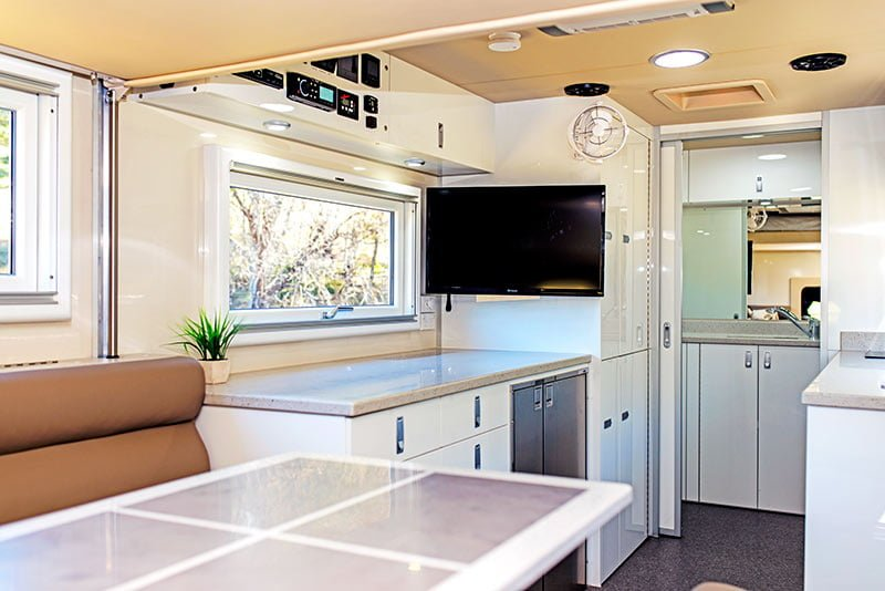 SLRV RVs interior - kitchen with TV